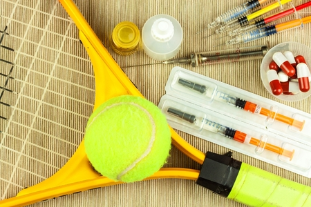 Tennis racket and ball. Anabolic steroids in tennis. Doping in sports
