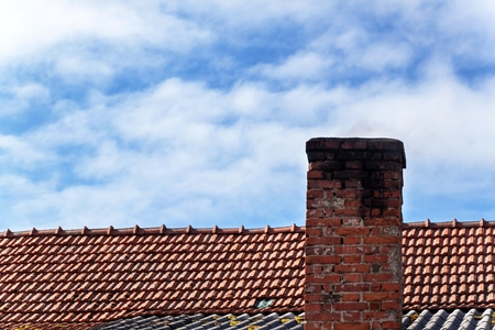 Old brick chimney. Chimney with sky in the background. Eco-friendly heating of a family house Stock Photo