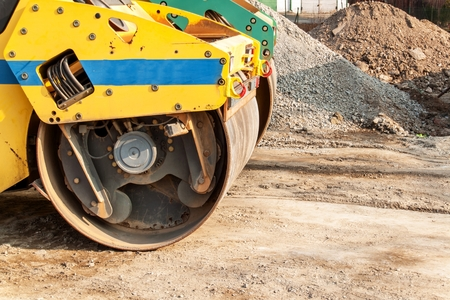Road roller working at road construction site. Detailed view of a road roller. Construction work