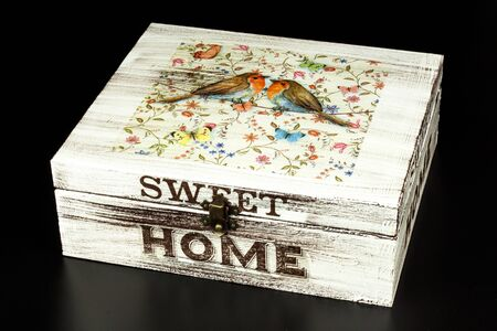 BRNO, CZECH REPUBLIC - 2 April, 2018: Products made by decoupage technique. Decoupage is a technique of decorating items of napkins. Decorated wooden box