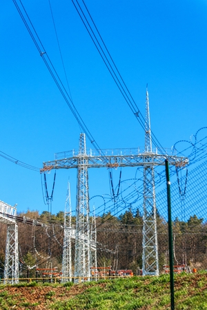 Production of electricity. Energy concept. Substation for high voltage conversion and distribution of electricity