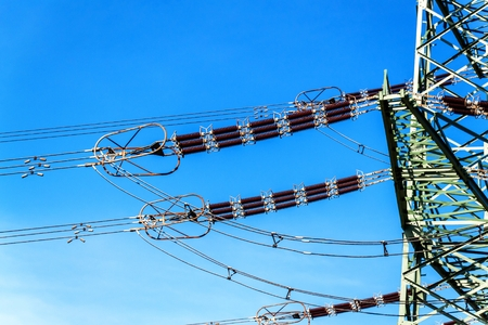 Production of electricity. Energy concept. Detail of high-voltage ceramic insulator. High Voltage Lead