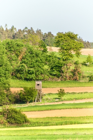 Wooden watchtower in the Czech landscape. Countryside in the Czech Republic. Wild game hunting