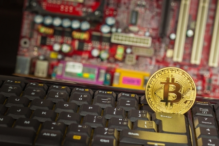 Bitcoin on a black computer keyboard. E-commerce. Virtual currency. Exchange speculation. Loss on the stock exchange. Share price