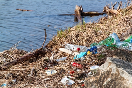 Plastic waste on lake shore in Czech Republic. Environmental pollution. Recycling of plastic waste. Stock Photo