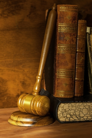 Wooden judge gavel, close-up view. Judges gavel on table. Law and order. Law and justice concept. Imagens