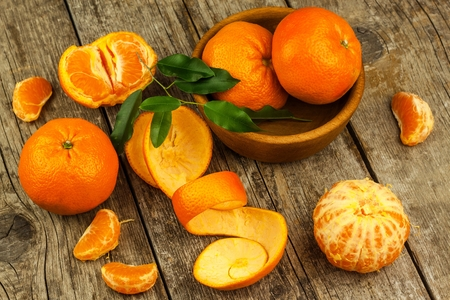 Fresh tangerines on old wooden board. Healthy exotic fruits. Diet food. Tangerine on the table.