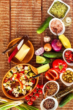 Preparation of vegetable salad with cheese. Diet healthy food. Summer salad with tomato and pepper. Vegetarian food.