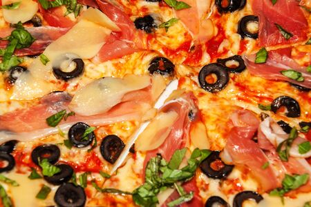 Close-up view of homemade pizza. Ingredients for pizza. Home preparation of fast food. Фото со стока