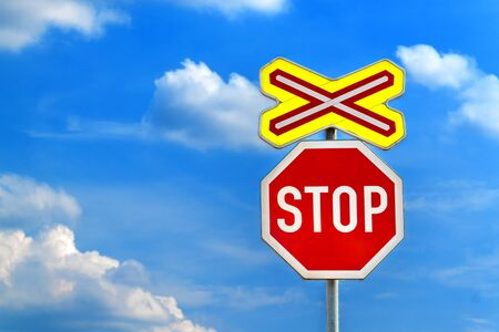 Warning sign on level crossing without barriers in Czech Republic, blue sky with clouds. Transport by rail. Danger!