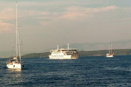 BRAC, CROATIA - August 31, 2019: Ferry Jadrolinija near Brac island in Croatia. Evening cruise to the port of Split. View from yacht. Stock Photo - 131611412