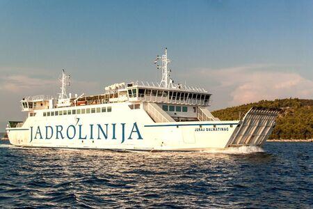 BRAC, CROATIA - August 31, 2019: Ferry Jadrolinija near Brac island in Croatia. Evening cruise to the port of Split. View from yacht. Stock Photo - 131611416