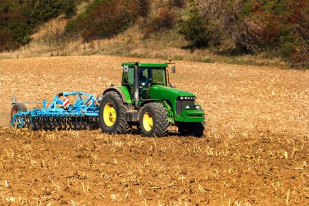 Tractor on  field. | Cultivation for loosening the soil. Tractor cultivates field. | Autumn work on agricultural farm in Czech Republic - Europe. Ecological agriculture.