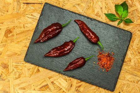 Fresh chilli peppers. Preparation of spicy food. Healthy spices. Extra hot chili pepper ( Capsicum Chinenses ) Bhut Jolokia Chocolate Stock fotó