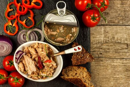 Canned Tuna Fish. Fishing industry. Pieces of Tuna with chilli. Healthy food. Fish can.