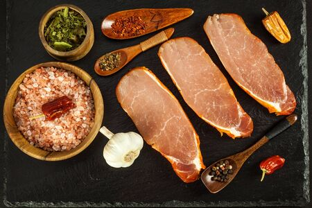 Marinated pork chop. Raw pork. Preparing for barbecue. Home food.