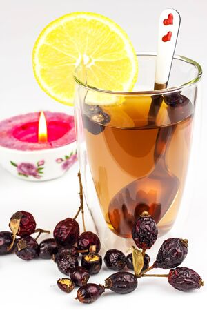 Rosehip tea. Alternative treatment for colds and flu. Dried rosehip. Glass with rosehip tea. Treatment of chills. Medicinal plants. 写真素材