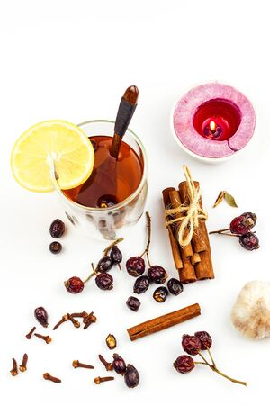 Rose hip tea. Alternative treatment for colds and flu. Dried rose hip. Glass with rose hip tea. Treatment of chills. Medicinal plants.