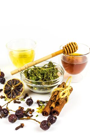 Medicinal herbal tea with honey on white background. Traditional treatment of flu and cold. Alternative medicine. Medicinal herbs.