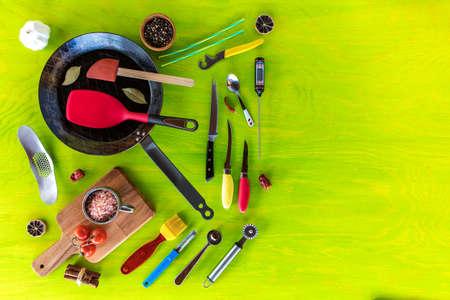 Kitchen utensils on a wooden background. Various kitchen utensils on wooden table. Chef tools. Home cooking.