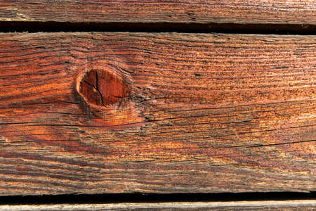 Texture of old brown wood with cracks and peeling paint, background. Old wooden background. Wooden table or floor. Standard-Bild