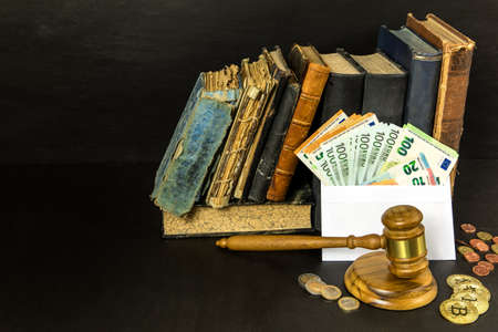 Money and judges hammer on wooden table. Representation of corruption and bribery in the judiciary. Bribery of judges.