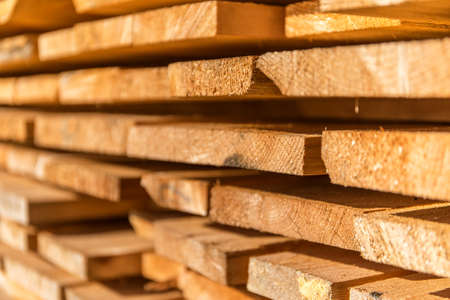 Wooden planks and beams. Air-drying timber stack. Wood air drying. Wood for house construction. Building material. Wood warehouse.