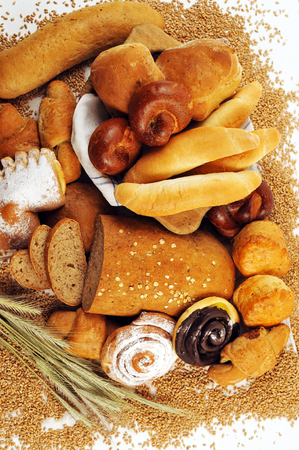 crus: Composition with bread and rolls in wicker basket, combination of pastries for bakery or market with wheat