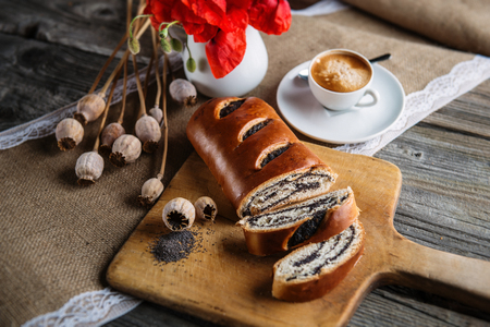 crus: Breakfast with coffee, flowers, red poppy, cake on the breadboard, cup of coffee, sweet baked desert, espresso Stock Photo