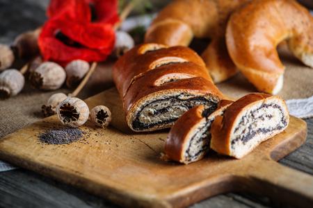 breadboard: Breakfast cake on the breadboard with poppy seeds, flowers, sweet baked desert