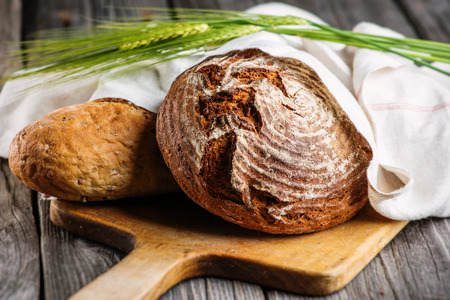 crus: rye bread with grains on wooden breadboard, food background, freshly baked traditional bread Stock Photo