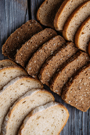 crus: Different bread slices, pastries combination, bread with grains, food background
