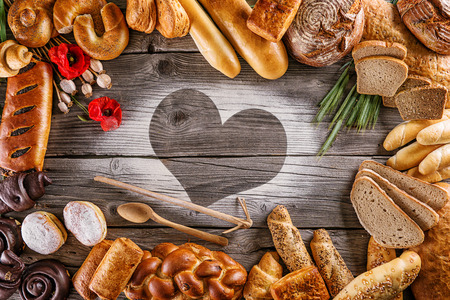 breads, pastries, christmas cake on wooden background with heart, picture for bakery or shop, valentines day Imagens