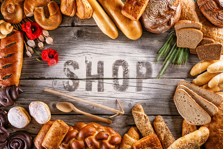 breads, pastries, christmas cake on wooden background with letters, picture for bakery or shop Stockfoto
