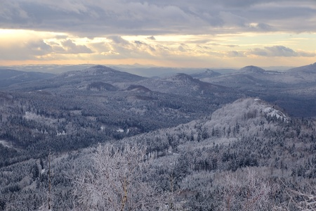 The view from Jedlova hora in Czech Republic. Landscape of Bohemian Switzerland National park in winter. Stock Photo