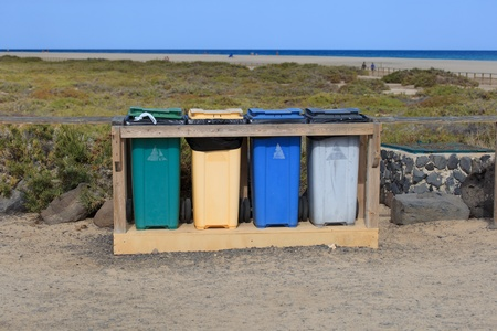 Recycling bins of different colors on the beach in Fuerteventura, Canary Islands Stock Photo - 102978357