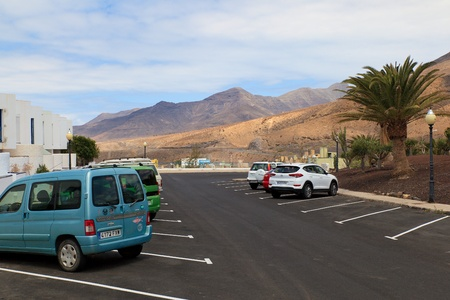 Morro Jable, Fuerteventura Spain, May 21, 2018: View of the car park and mountains in the background in Morro Jable Fuerteventura- Canary Islands