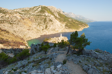 View of the shores of the Adriatic Sea and the Biokovo Mountains in the background in Croatia Stock Photo