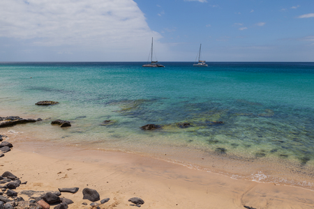 A beautiful coastline of the Atlantic ocean with sailboats in Morro Jable Fuerteventura- Canary Islands
