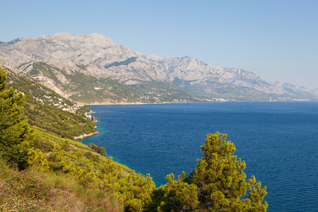 View of the shores of the Adriatic Sea and the Biokovo Mountains in the background in Croatia Stock Photo - 115743780
