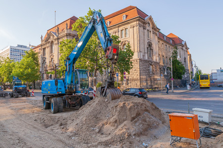 Berlin, Germany - May 14, 2018: Excavator in the streets of Berlin