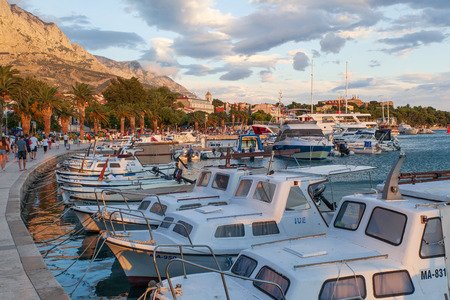 Baska Voda, Croatia, July 23, 2018: View of the harbor in Baska Voda and the Biokovo Mountains in the background in Croatia Editorial