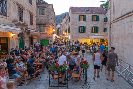 Omis, Croatia, July 19, 2018: Street with people and cafes at old city center in Omis, Dalmatia, Croatia Stock Photo - 114942633