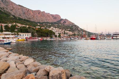 Omis, Croatia, July 19, 2018: SailBoats and the harbor in the Adriatic Sea in Omis, Dalmatia, Croatia Editorial