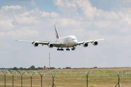 Prague, Czech Republic, July 13, 2018: Airbus 380-800 Emirates Airlines in low level flight for landing approach  in Prague International Airport, Czech Republic.