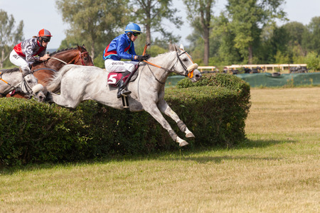 Lysa nad Labem, Czech Republic, July 6, 2018: Jockey and his horse jumps over the hedge