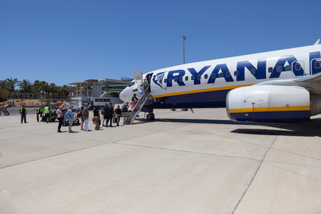Fuerteventura, Spain - May 22, 2018 : Passengers entering the aircraft in Fuerteventura airport Stock Photo - 114942650