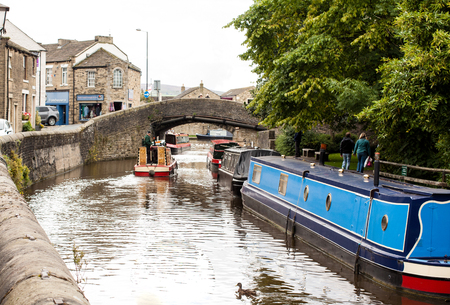 The barges on the canal with a stone bridge