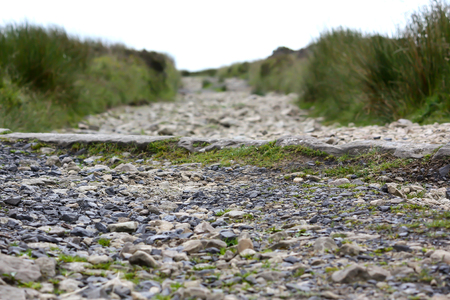The narrow stone path across the moors to the top of the hill Stock Photo
