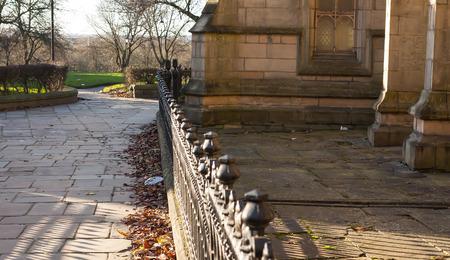 The iron railings alonside the stone church